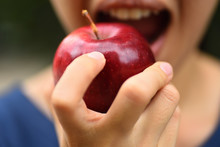 Midsection Of Woman Eating Apple
