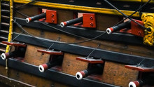Old Wooden Ship, Side With Cannons In Museum Of Amsterdam. Close Up