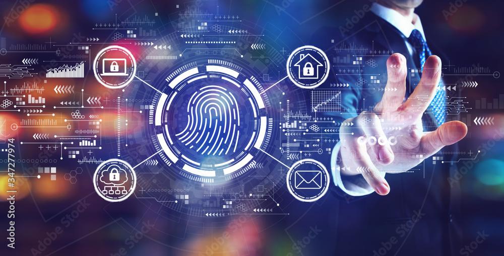 Fototapeta Fingerprint scanning theme with businessman on night city background