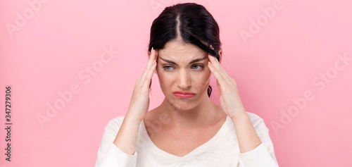 Fototapeta Young woman feeling stressed on a pink background obraz