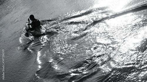 Canvas Print Man Kayaking In River
