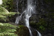 View Of Waterfall Along Rocks
