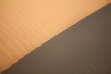 Shadow On Sand Dunes In Desert