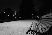 Empty Bench On Roadside In City At Night
