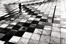 Person Walking On Tiled Floor