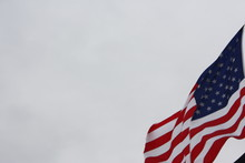 Close-up Of Cropped American Flag Against Clear Sky
