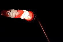Low Angle View Of Windsock Against Sky At Night
