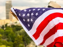 Close-up Of American Flag Against Sky