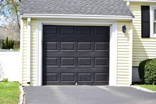 A  One Car Garage Door Painted...