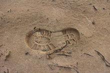 Close-up Of Shoe Print On Sand