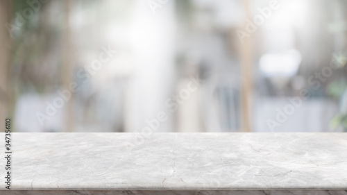 Obraz na plátně Empty white marble stone table top and blur glass window interior lobby and hall way banner mock up abstract background - can used for display or montage your products