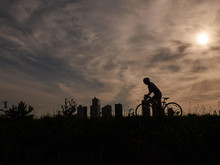 Silhouette Of Cyclist Riding At Sunrise