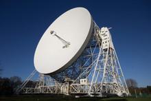 White Satellite Dish Against B...