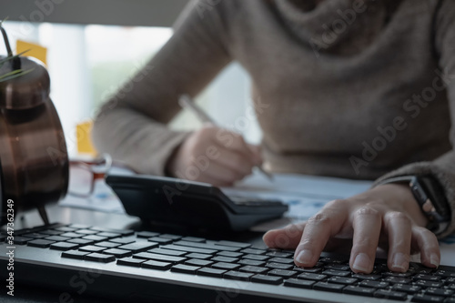 Fototapety, obrazy: Business man investment consultant analyzing company annual financial report balance sheet statement working with documents graphs. Concept picture of business, market, office, tax.