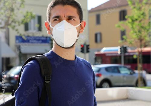 COVID-19 Pandemic Coronavirus Man in city street wearing KN95 FFP2 face mask protective for spreading of Coronavirus Disease 2019 Canvas Print