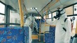 People in protective suits kill virus in a bus during disinfection.