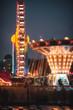 Leinwandbild Motiv Illuminated Amusement Park Rides At Night