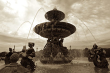 Fountain With Sculptures In Lake Against Sky