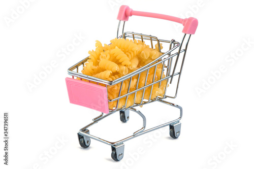 Fotografia, Obraz grocery cart in which the pasta lies on a white background