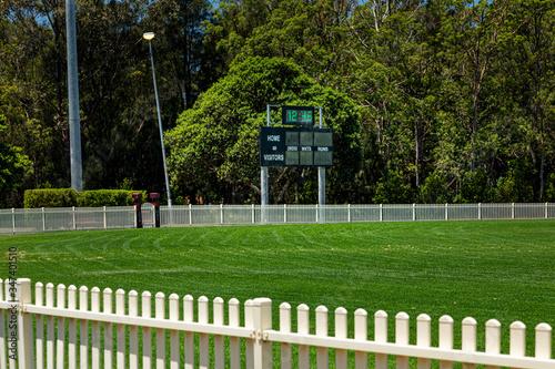 Fototapeta Cricket Score Board and grass field obraz na płótnie