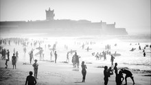Crowd At Beach During Foggy Weather