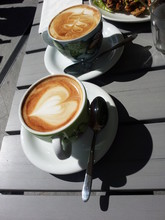Two Cups Of Coffee Served On A Table