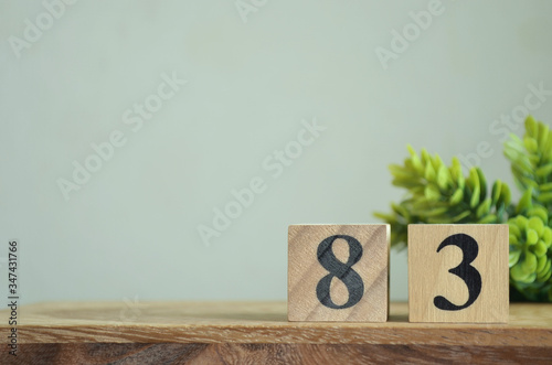 Fotografia Number 83, Rating, Award, Design with number cube colorful stone in natural concept