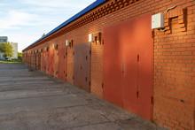 Row Of Brick Garages In A Sunn...