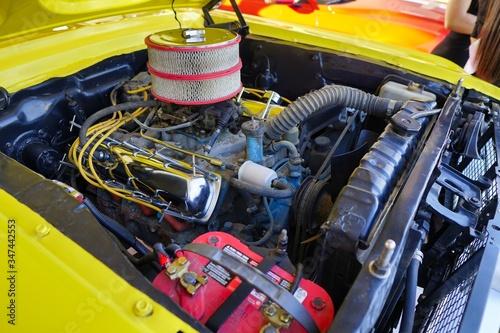 Fototapeta Closeup shot of a modified motor of a yellow car