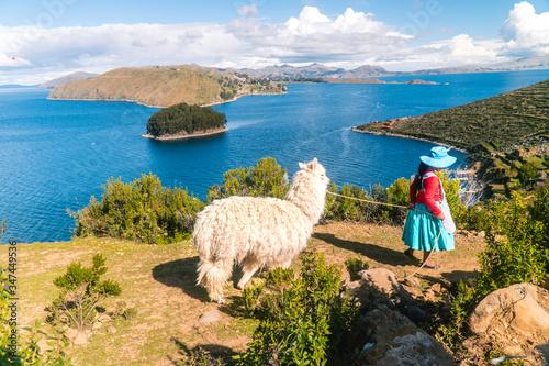 Girl and Llama Alpaca with Island on Isla del Sol in Bolivia background. Scenic panoramic view of island, sea horizon. Bolivian island paradiseand hills. Tourist walking trail. Tourism. Titicaca lake