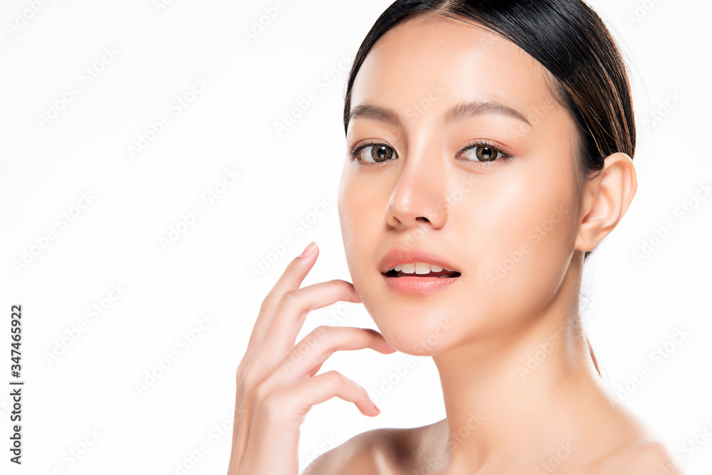 Fototapeta Beautiful Young Asian Woman with Clean Fresh Skin. Face care, Facial treatment, Cosmetology, beauty and healthy skin and cosmetic concept, woman beauty skin isolated on white background