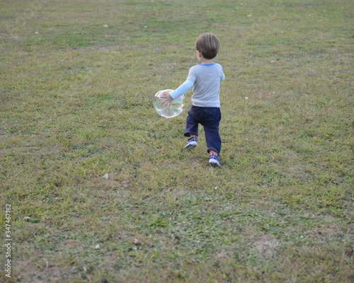 Boy Running With Soap Suds Bubble Tablou Canvas