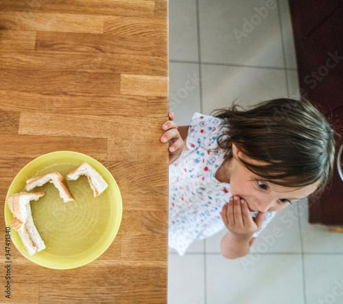 Cute girl ate all sandwiches Canvas Print