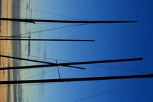 Close-up Of Ship Masts Against A Blue Sky
