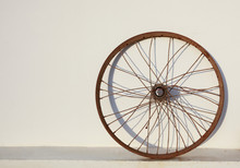Old Rusty Bicycle Wheel On Wal...