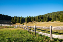 A Rural Fence With Pastures In...