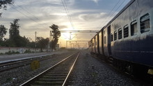 View Of Railway Tracks At Sunset