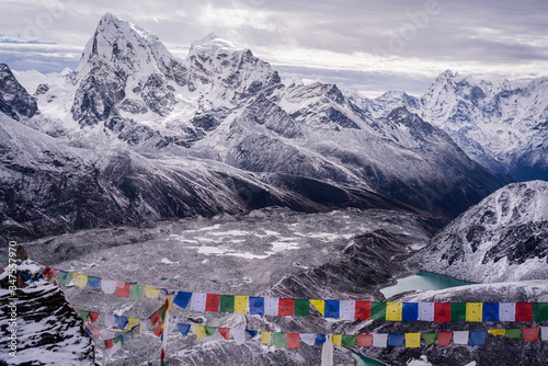 Fototapeta Prayer flags of Gokyo Ri with view of mountain and terminal moraine