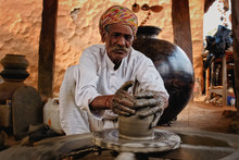 Indian Potter At Work: Throwin...