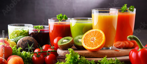 Fototapeta Glasses with fresh organic vegetable and fruit juices obraz