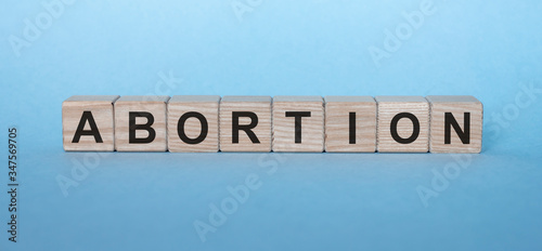 abortion word on wooden cubes on blue background Canvas Print