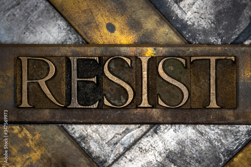 Photo of real authentic typeset letters forming Resist text on vintage textured Canvas Print