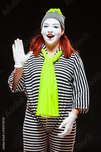 Платно Portrait of female mime artist, isolated on black background