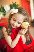 Girl Gently Hugs A Chicken. Closeup Portrait Of A Girl. Easter Is Approaching Chick And The Girl.