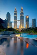 Illuminated Petronas Towers Against Sky At Twilight