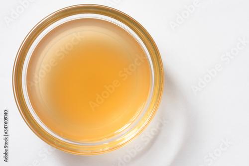 Fényképezés Apple Cider Vinegar in a Bowl