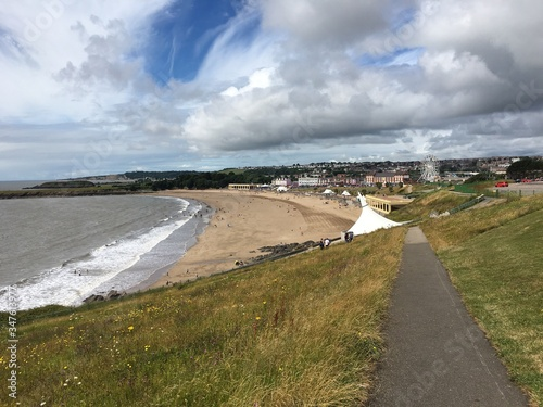 Fotografie, Obraz Beach Against Cloudy Sky At Barry Island
