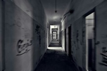 Blurred Narrow Corridor With Graffiti On Wall In Abandoned Building