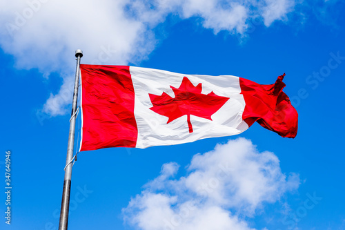 Fototapeta Waving Canadian flag with blue sky in background obraz