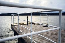 Metal Railing On Pier Against Sky